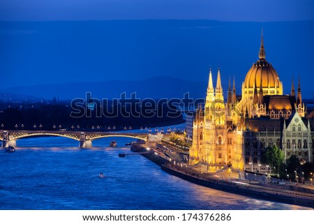 Hungarian Parliament Building and Danube river by night in Budapest, Hungary. - stock photo
