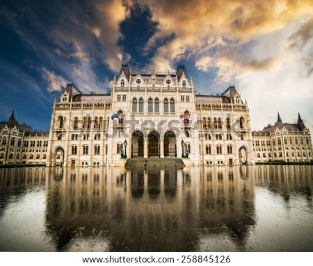 Hungarian Parliament building with reflection  at sunset in Budapest, Hungary - stock photo