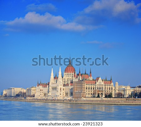 Hungarian Parliament standing by river Danube in Budapest, Hungary - stock photo