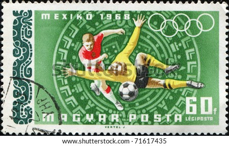 HUNGARY - CIRCA 1968: A post stamp printed in Hungary shows soccer players, circa 1968