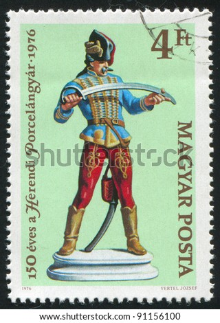 HUNGARY - CIRCA 1976: A stamp printed by Hungary, shows Hussars figurine, Herendi, china, circa 1976