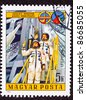 HUNGARY - CIRCA 1986:  A stamp printed in Hungary commemorating Soviet-Hungarian cooperation on space exploration.  Two cosmonauts/astronauts waving from the launch platform, circa 1986. - stock photo