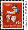 HUNGARY - CIRCA 2007: A stamp printed in Hungary dedicated to Easter, shows a man pouring water a girl, circa 2007 - stock photo