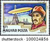 "HUNGARY - CIRCA 1977: A stamp printed in Hungary from the ""Airships"" issue shows Alberto Santos-Dumont and airship Ballon No. 5 over Paris, circa 1977. - stock photo"