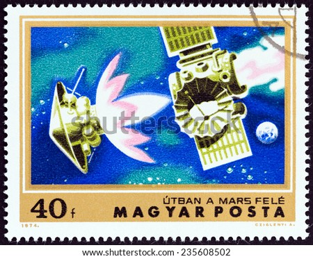 "HUNGARY - CIRCA 1974: A stamp printed in Hungary from the ""Mars Exploration "" issue shows Mariner 4 on course for Mars, circa 1974.  - stock photo"