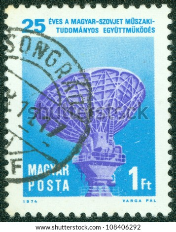 HUNGARY - CIRCA 1974: A stamp printed in Hungary honoring 25th Anniversary of Technical and Scientific Co-operation between Hungary and Soviet Union, shows Intersputnik Satellite Tracking Radar