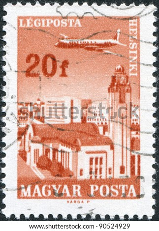 HUNGARY - CIRCA 1966: A stamp printed in Hungary, is depicted Helsinki, airplane, Grand Central Station and the Central Post Office, circa 1966 - stock photo