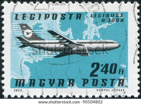 HUNGARY - CIRCA 1977: A stamp printed in Hungary, is devoted to airmail, shows Airbus A300B over the map of Europe, circa 1977 - stock photo