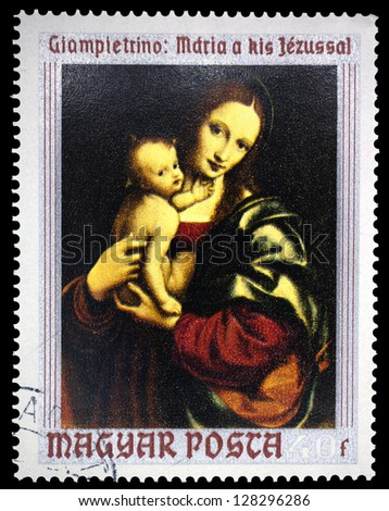 "HUNGARY - CIRCA 1970: A stamp printed in Hungary, shows a picture Virgin and Child by Giampietrino, with the same inscription, series ""Religious Art from Christian Museum, Esztergom"", circa 1970 - stock photo"