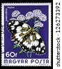 """HUNGARY - CIRCA 1974: A Stamp printed in Hungary shows butterfly Marbled White, with the same inscriptions, from the series """"Butterflies and Moths"""", circa 1974 - stock photo"""