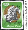 "HUNGARY - CIRCA 1973: A stamp printed in Hungary, shows equestrian sport and Gold medal, with inscription ""Munich, 1972"", series ""Hungarian Medal Winners, Olympic Games in Munich, 1972"", circa 1973 - stock photo"