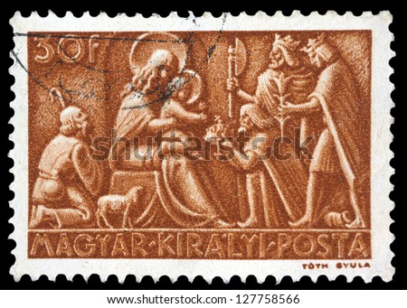 "HUNGARY - CIRCA 1943: A stamp printed in Hungary shows relief ""Adoration of the Magi"", without inscription, from the series ""Christmas"", circa 1943 - stock photo"