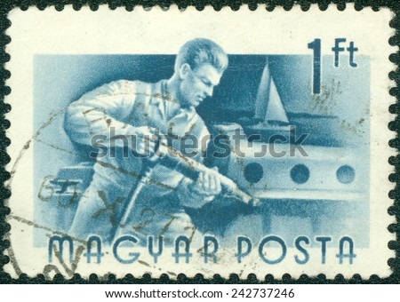 """HUNGARY - CIRCA 1955 : A stamp printed in Hungary shows Riveter, without inscription, from the series """"Hungary Workers"""", circa 1955 - stock photo"""