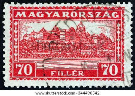 HUNGARY - CIRCA 1927: A stamp printed in Hungary shows Royal Palace, Budapest, circa 1927. - stock photo