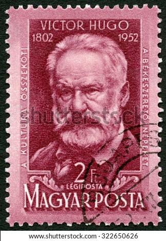 HUNGARY - CIRCA 1952: A stamp printed in Hungary shows Victor Marie Hugo (1802-1885), 150th birth anniversary, circa 1952 - stock photo