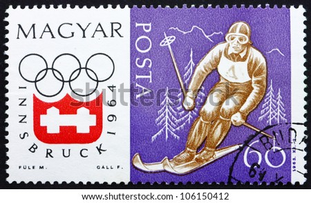 HUNGARY - CIRCA 1963: a stamp printed in the Hungary shows Downhill Skiing, Winter Olympic sports, Innsbruck 64, circa 1963 - stock photo