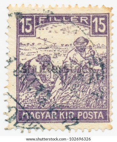 HUNGARY - CIRCA 1916: A stamp printed in the Hungary shows Harvesting Wheat (White Numerals), circa 1916