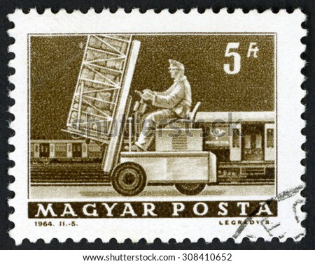 HUNGARY - CIRCA 1964: post stamp printed in Magyar shows hydraulic lift truck & mail car; Scott 1525 A337 5fo brown, circa 1964 - stock photo
