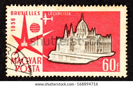 HUNGARY - CIRCA 1958: Red color stamp printed in Hungary with image of a cathedral to commemorate the Expo 58 also known as Brussels World's Fair, circa 1958.  - stock photo