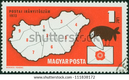 HUNGARY - CIRCA 1973: stamp printed by Hungary, shows Postal Zone Map of Hungary and letter-carrying crow, circa 1973 - stock photo
