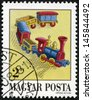 HUNGARY - CIRCA 1988: stamp printed by Hungary, shows Train, Antique Toy, circa 1988 - stock photo