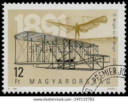 "HUNGARY - CIRCA 1991: Stamp printed in Hungary from the ""The 100th Anniversary of Airplanes"" issue shows Wright brothers and plane 1903, circa 1990.  - stock photo"