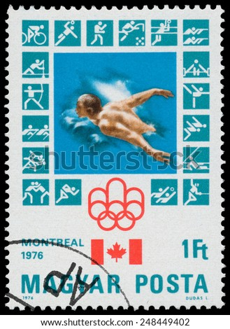HUNGARY - CIRCA 1976: stamp printed in Hungary, shows Montreal Olympic Emblem, Canadian Flag, Swimming, circa 1976  - stock photo