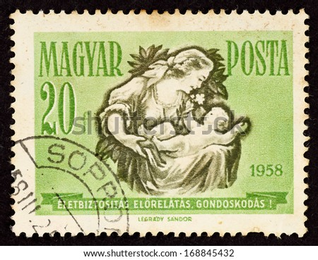 HUNGARY - CIRCA 1958: Stamp printed in Hungary with image of a mother and a baby, circa 1958.