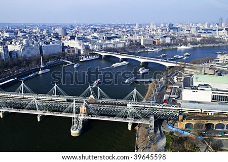 Hungerford bridge seen from London Eye in England - stock photo