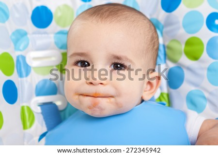 Hungry dirty cute little boy  - stock photo