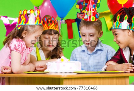 Hungry kids looking at birthday cake - stock photo