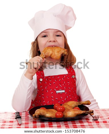 hungry little girl cook eat chicken drumstick  - stock photo