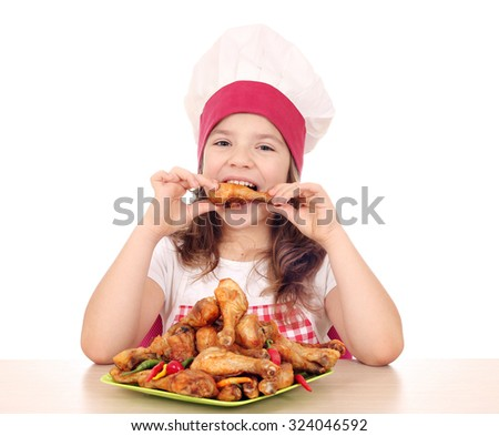 hungry little girl cook eating chicken drumstick - stock photo