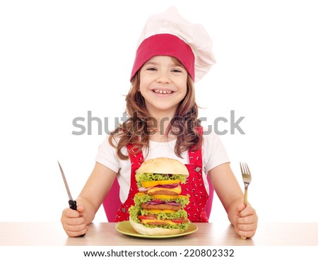 hungry little girl cook with big hamburger - stock photo