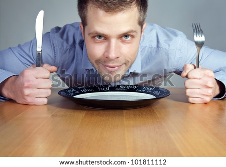 Hungry man waiting for dinner - stock photo