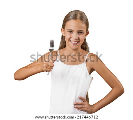 Hungry. Smiling teenager girl holding a fork, isolated on white background. Positive face expressions, emotions