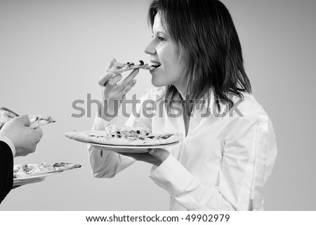 hungry woman eating pizza - stock photo
