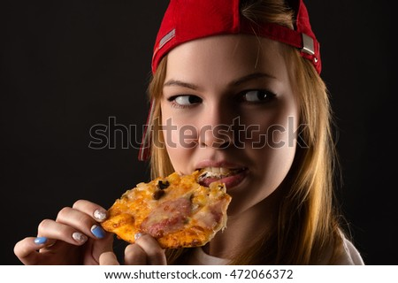 hungry young woman eating pizza
