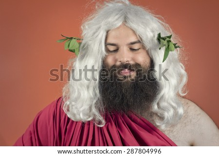 Hungry zeus god or jupiter against orange background - stock photo