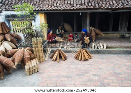 HUNGYEN, VIETNAM - FEB 7 :Unidentified women was weaving bamboo on February 7, 2015 in HungYen, Vietnam. Weaving this tools that used to catch fish is traditional occupation in Hung Yen province.