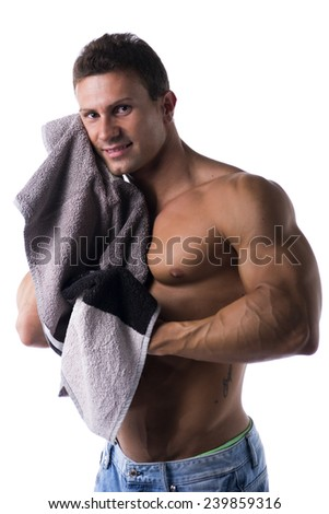 Hunky male bodybuilding model drying himself with a grey towel, isolated on white background