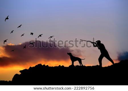 Hunter and dog - stock photo