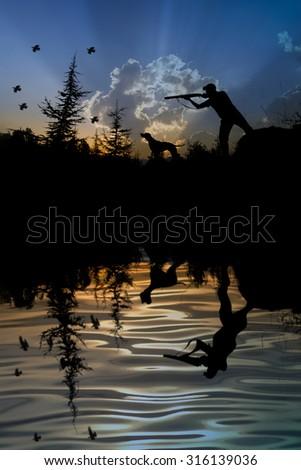 Hunter and dog at sunset - stock photo