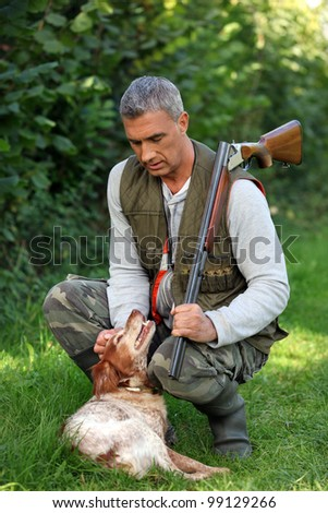 hunter and dog outdoors - stock photo