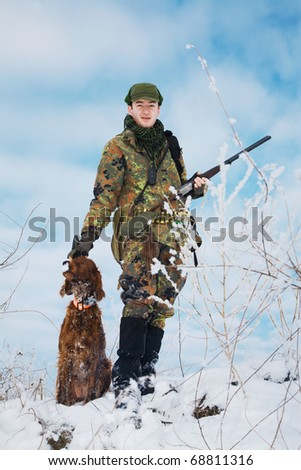 Hunter and his dog waiting for the hunt to begin