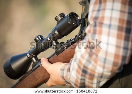 hunter holding a rifle
