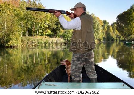 hunter in boat - stock photo