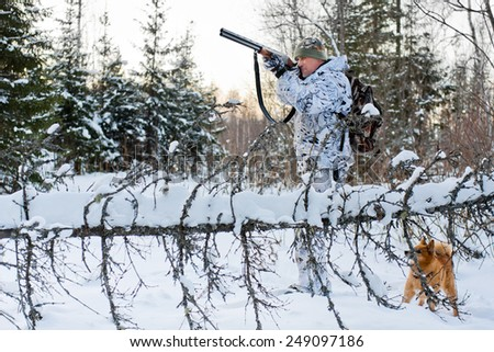 hunter in camouflage on winter hunting - stock photo
