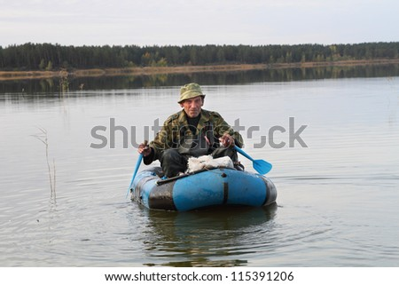 Hunter is floating in an inflatable boat on the lake
