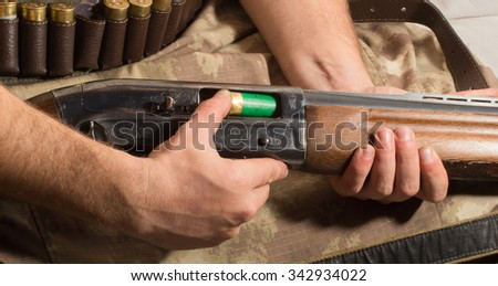 hunter load ammo in the gun - stock photo